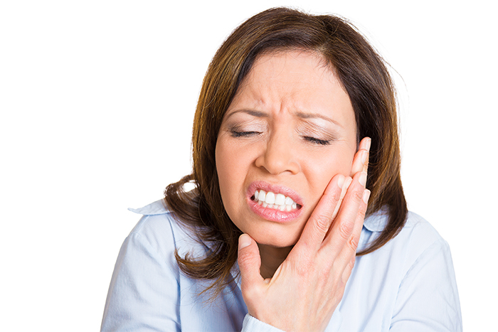 woman with tooth pain