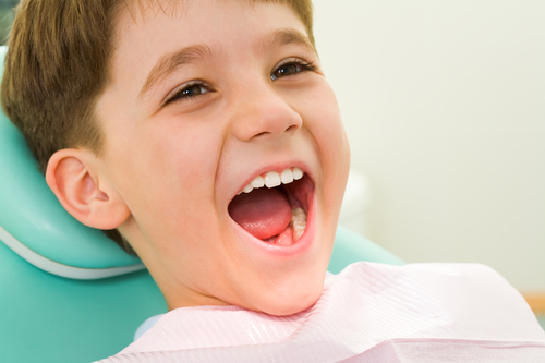 Checking child's teeth